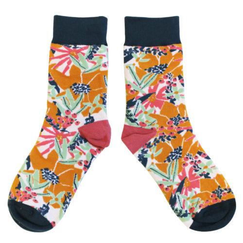 Socks in a box, mustard flowers