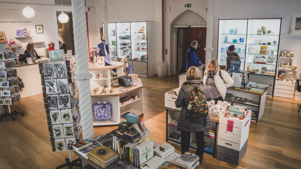 Photo of the shop at RAMM with visitors browsing for products