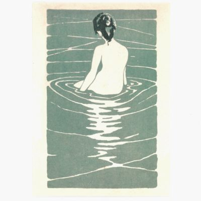 Female nude seated in water